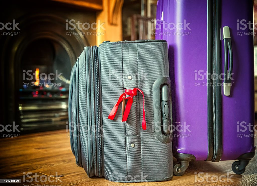 Suitcases packed for winter travel stock photo