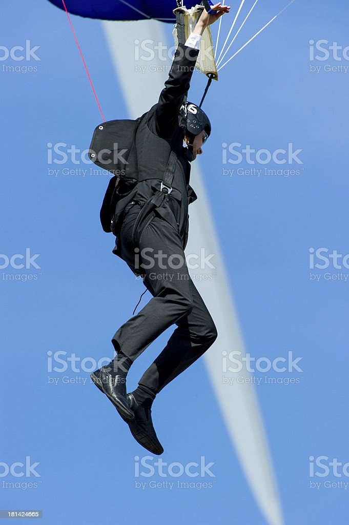 Suited BASE jumper stock photo