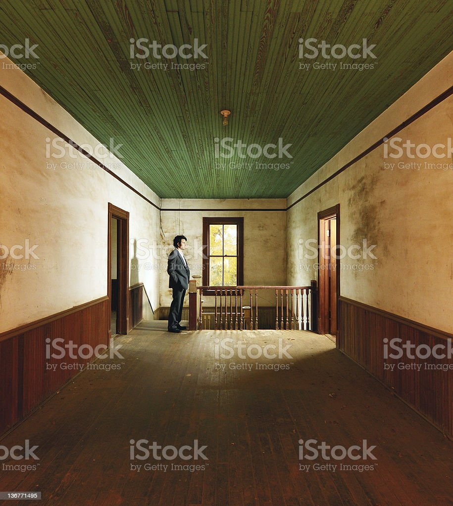 Suited man in Antique Home royalty-free stock photo