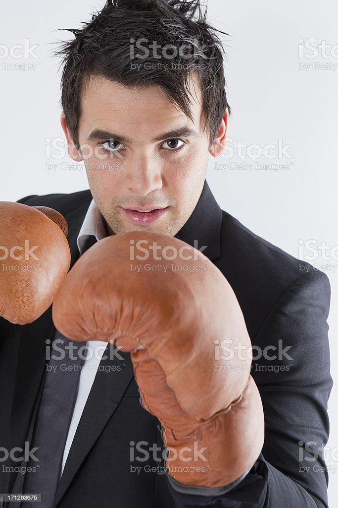 Suited Man Wearing Boxing Gloves royalty-free stock photo