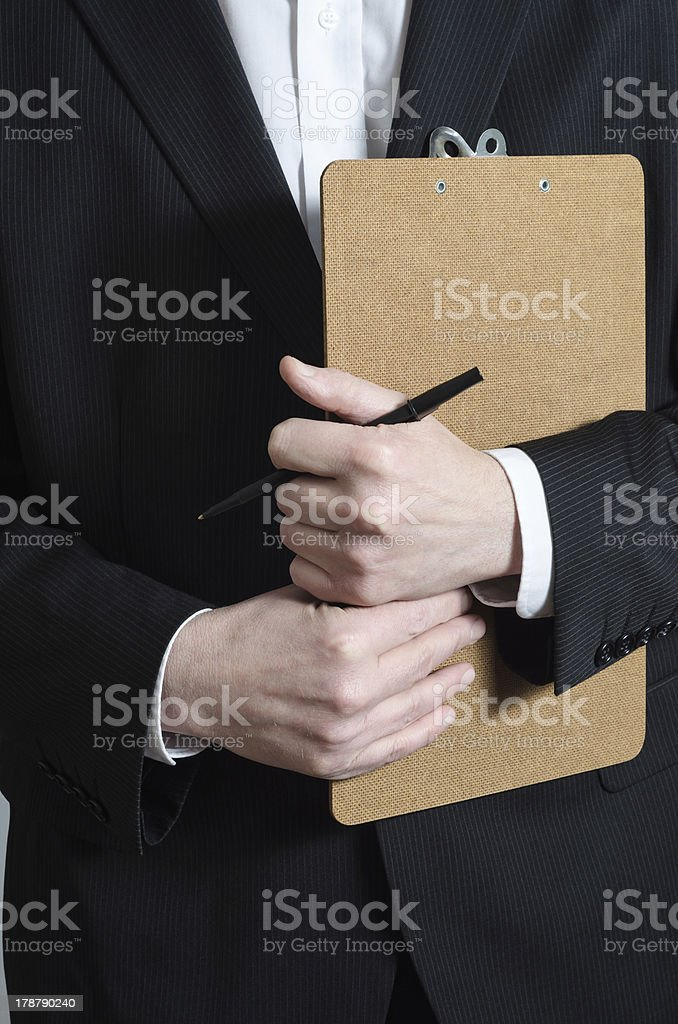Suited Man with Clipboard stock photo