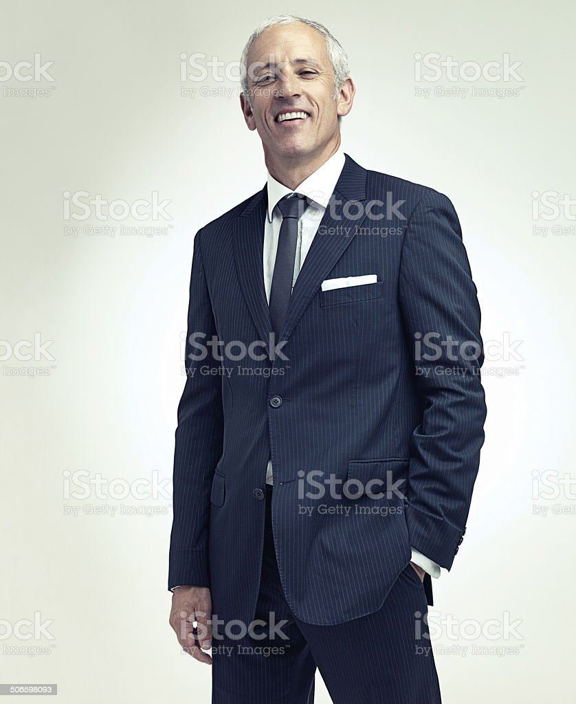 Suited up and smiling stock photo