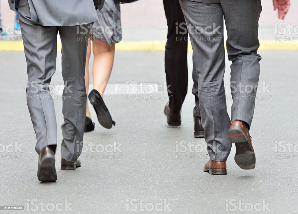 Suits crossing street, motion blur stock photo