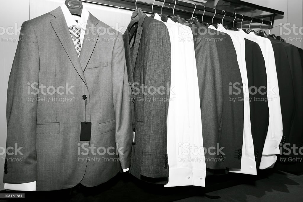 Suits on hangers in a row. stock photo