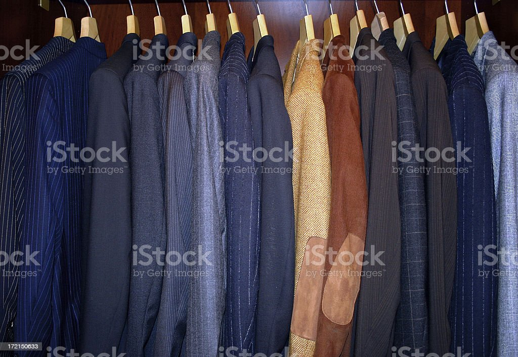 Suits on racks royalty-free stock photo