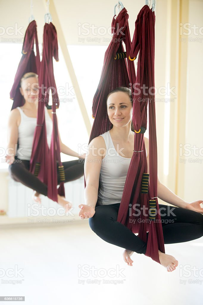 Sukhasana yoga pose in hammocks stock photo