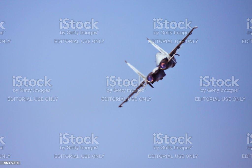 Sukhoi 30 MKI flying fast against blue sky stock photo