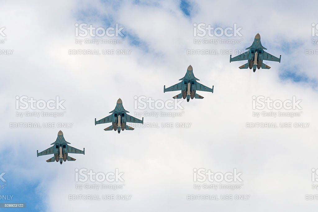 Sukhoi Su-34 Fullback aircrafts fly over Red Square. stock photo