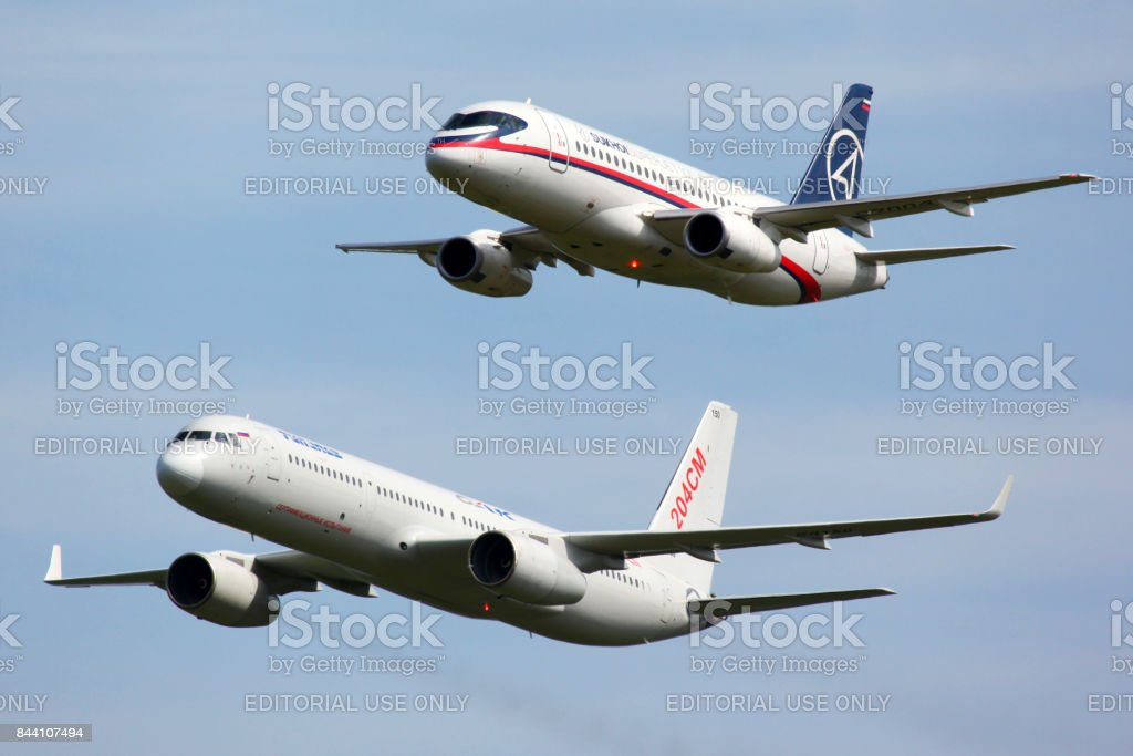 Sukhoi Superjet 100 97004 shown together with Tupolev Tu-204SM 64150 at MAKS-2011 airshow in Zhukovsky stock photo