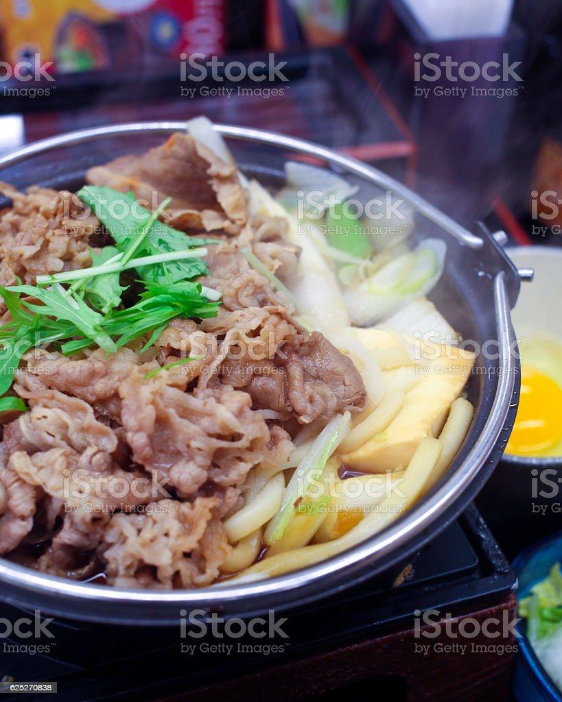 Sukiyaki served in hot pot stock photo