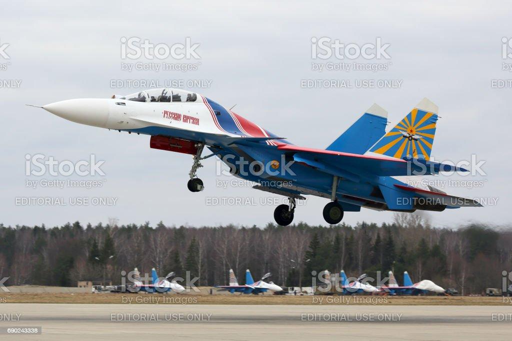 Sukoi Su-30SM 32 BLUE of Russian Knights aerobatics team of Russian air force during Victory Day parade rehearsal at Kubinka air force base. stock photo