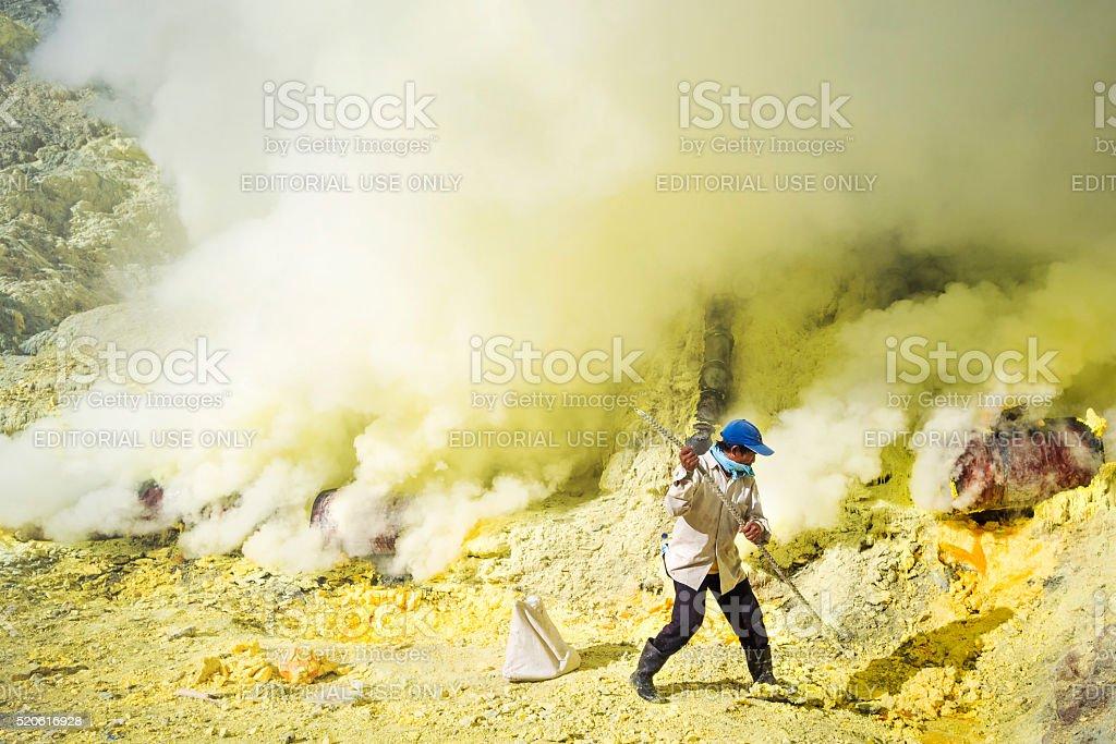 Sulfur Miner at Kawah Ijen Volcano, East Java, Indonesia stock photo
