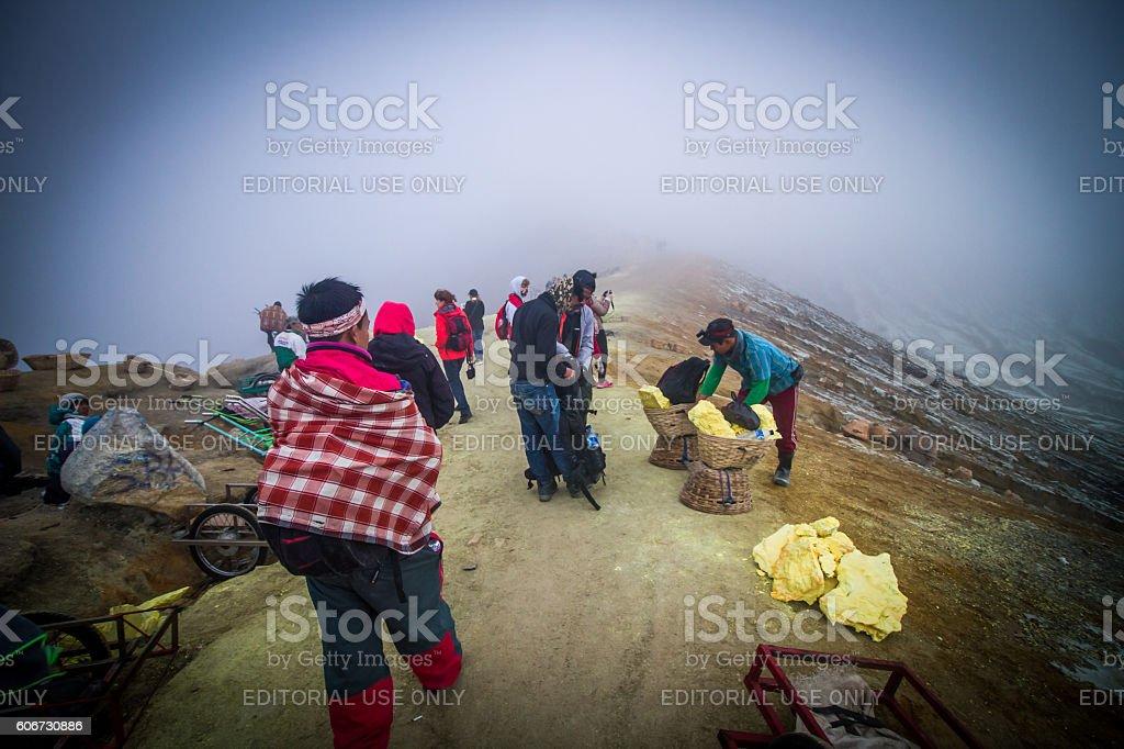 Sulfur miners working stock photo