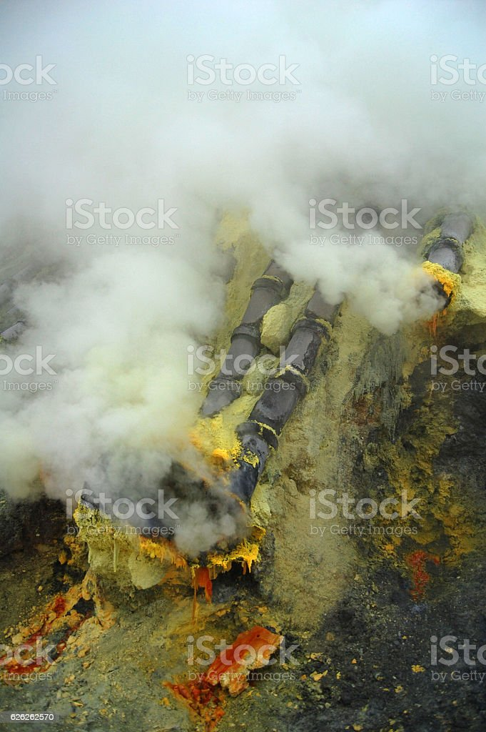Sulfur mining at the crater of active volcano Ijen, Indonesia stock photo