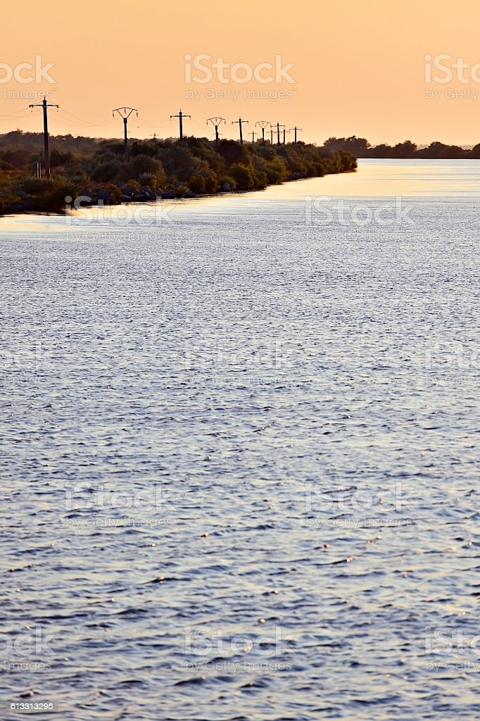 Sulina river branch at sunset stock photo