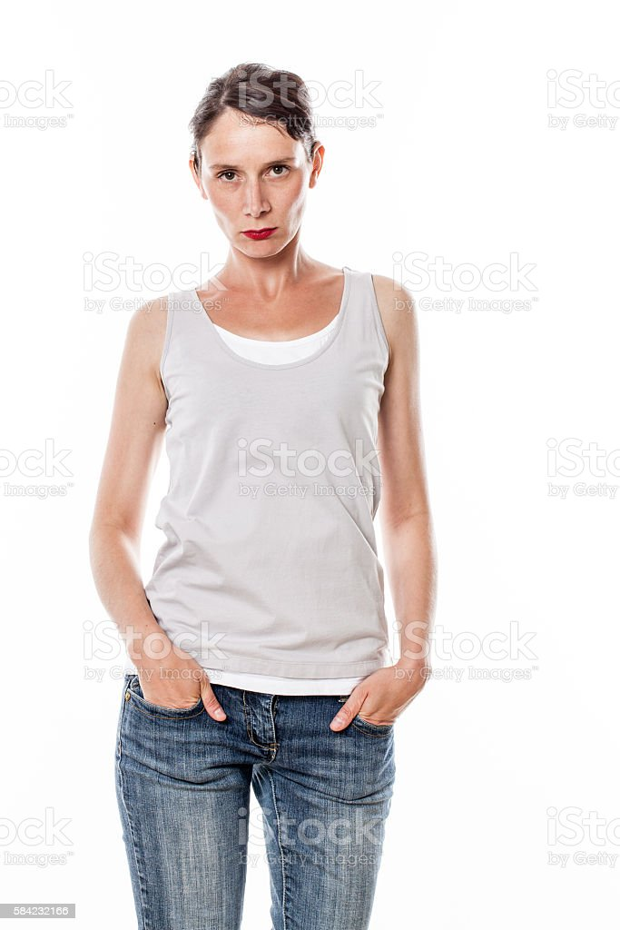 sulking beautiful young woman with hands in jeans pockets stock photo