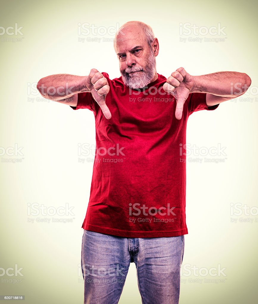 Sullen Adult Red Shirt Man Thumbs Down Hand Gesture stock photo