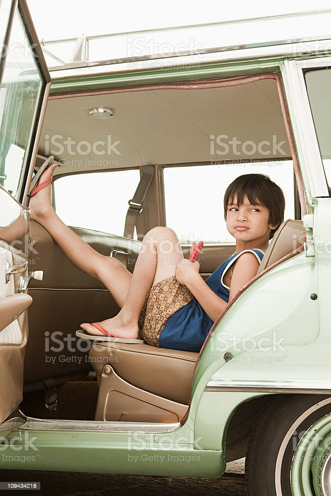 Sullen boy sitting in car royalty-free stock photo