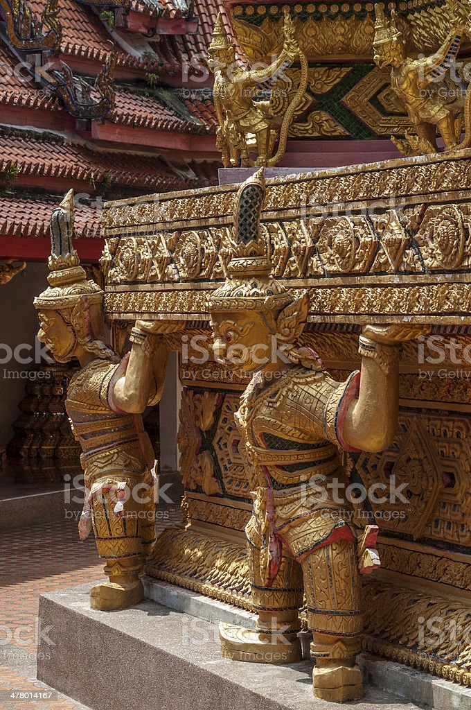 Sulptures  mystical creature in the interior of a Buddhist temple royalty-free stock photo