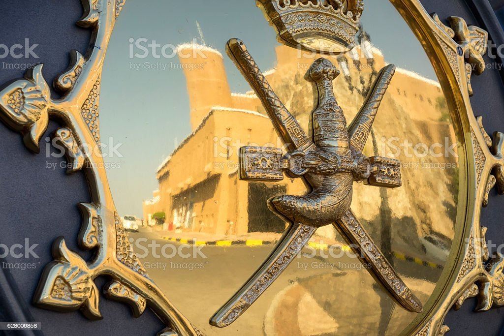 Sultan of Oman Coat of Arms with Al Mirani Fort reflection stock photo