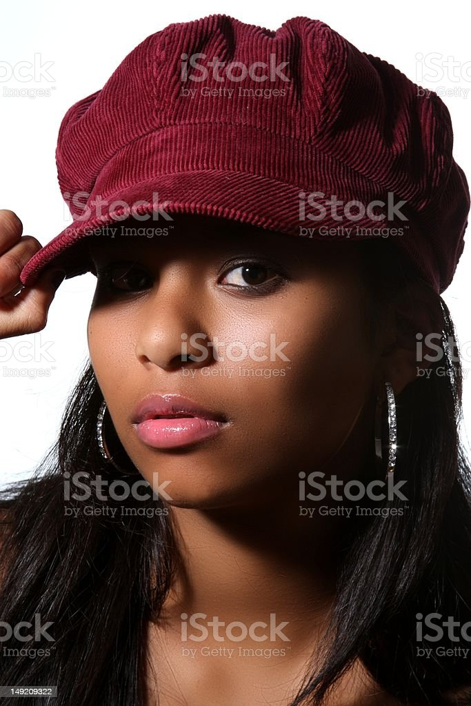 Sultry beauty wearing red cap stock photo
