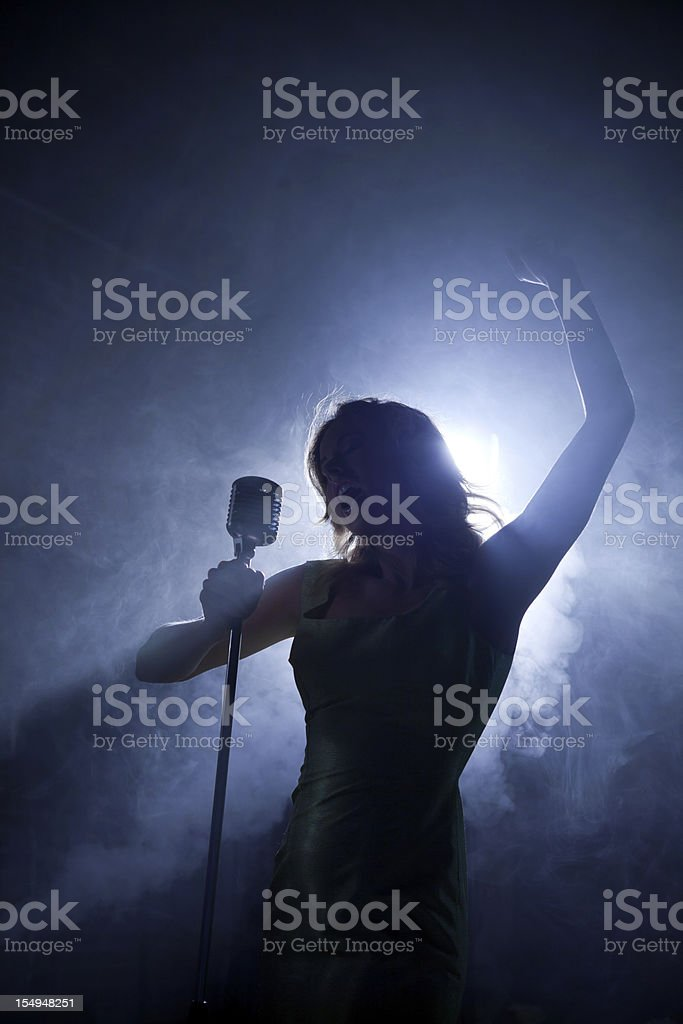 Sultry singer striking a pose stock photo