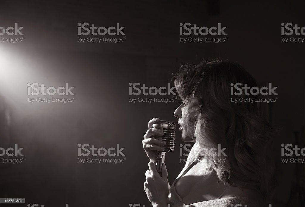 Sultry woman singing stock photo