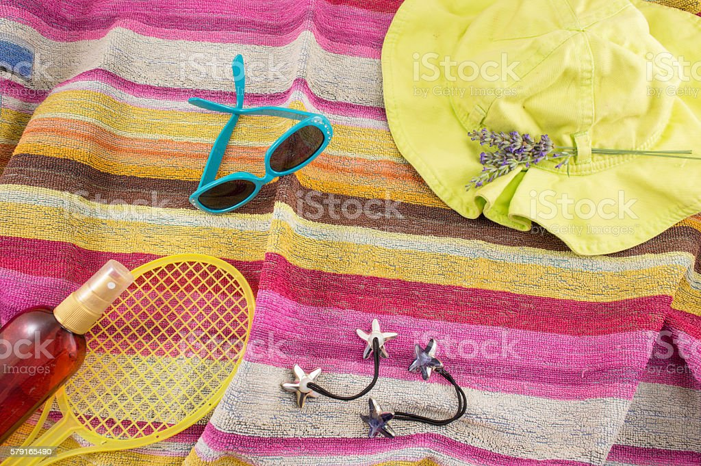 Summer accessories on beach towel stock photo
