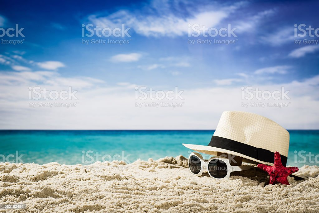 Summer accessories on coastline or beach stock photo