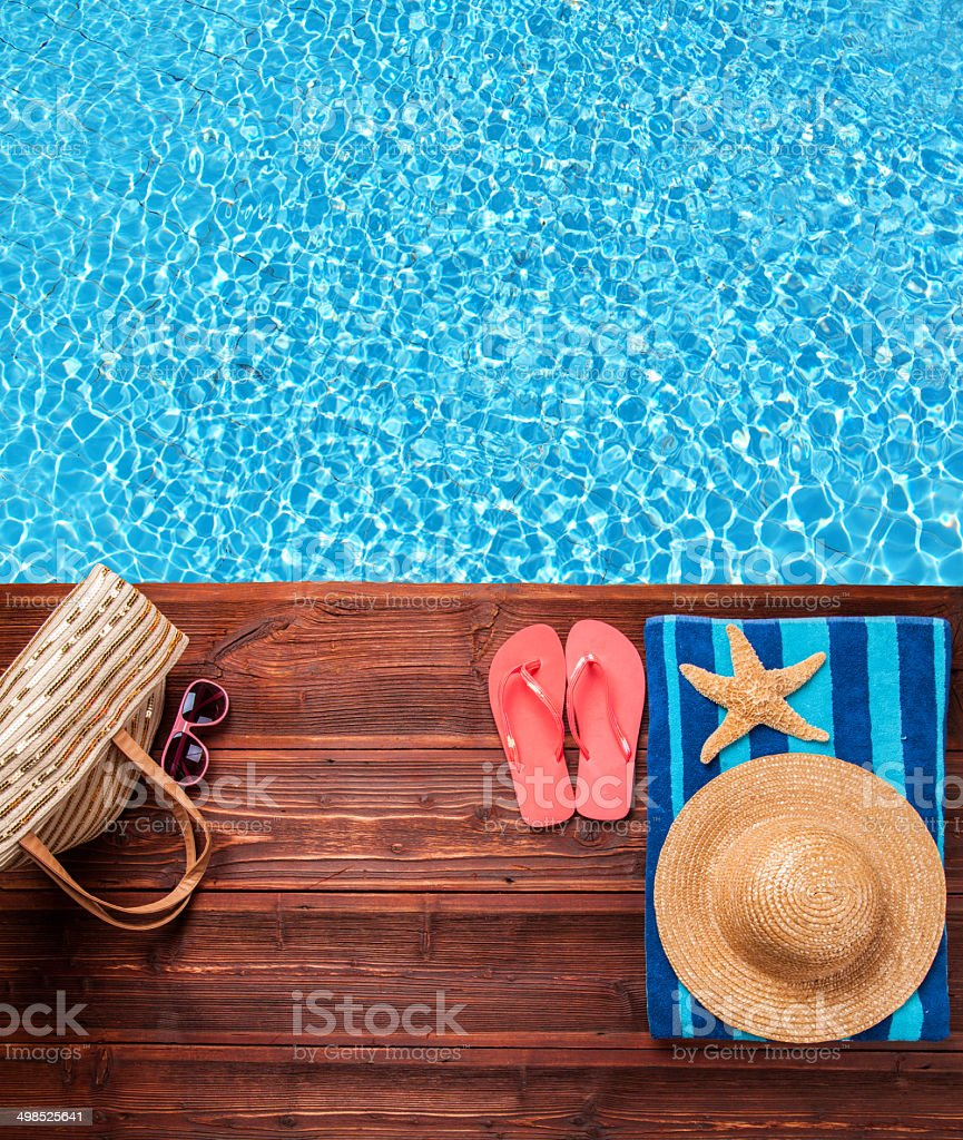 Summer accessories on wooden planks stock photo