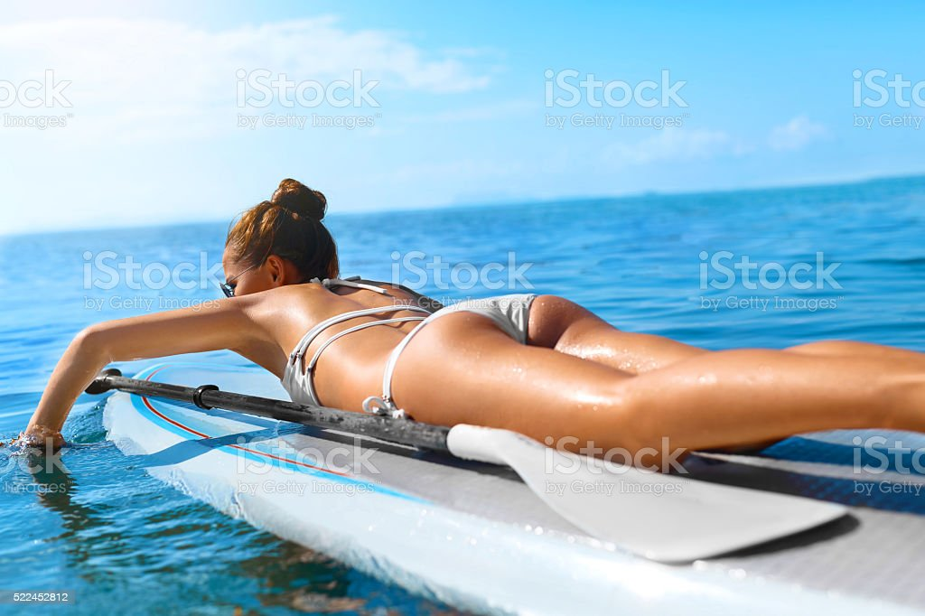 Summer Adventure. Water Sports. Woman Surfing In Ocean. Healthy stock photo