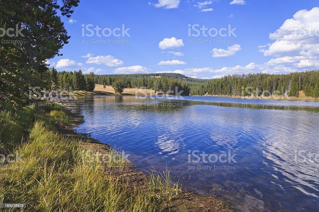 summer afternoon on beautiful lake in Yellowstone National Park stock photo