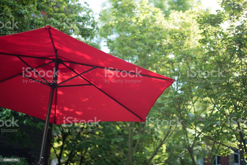 Summer afternoon red sunshade umbrella stock photo