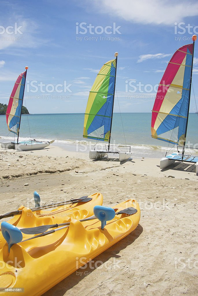 summer afternoon; watersports equipment on exotic beach royalty-free stock photo