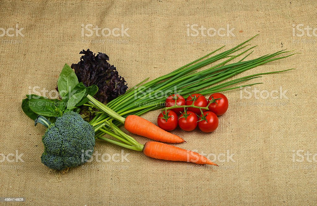 Summer artisan vegetables and greens at canvas royalty-free stock photo