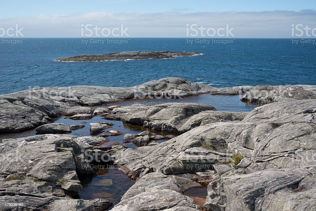 Summer at rocky beach in Norwegian fjord stock photo