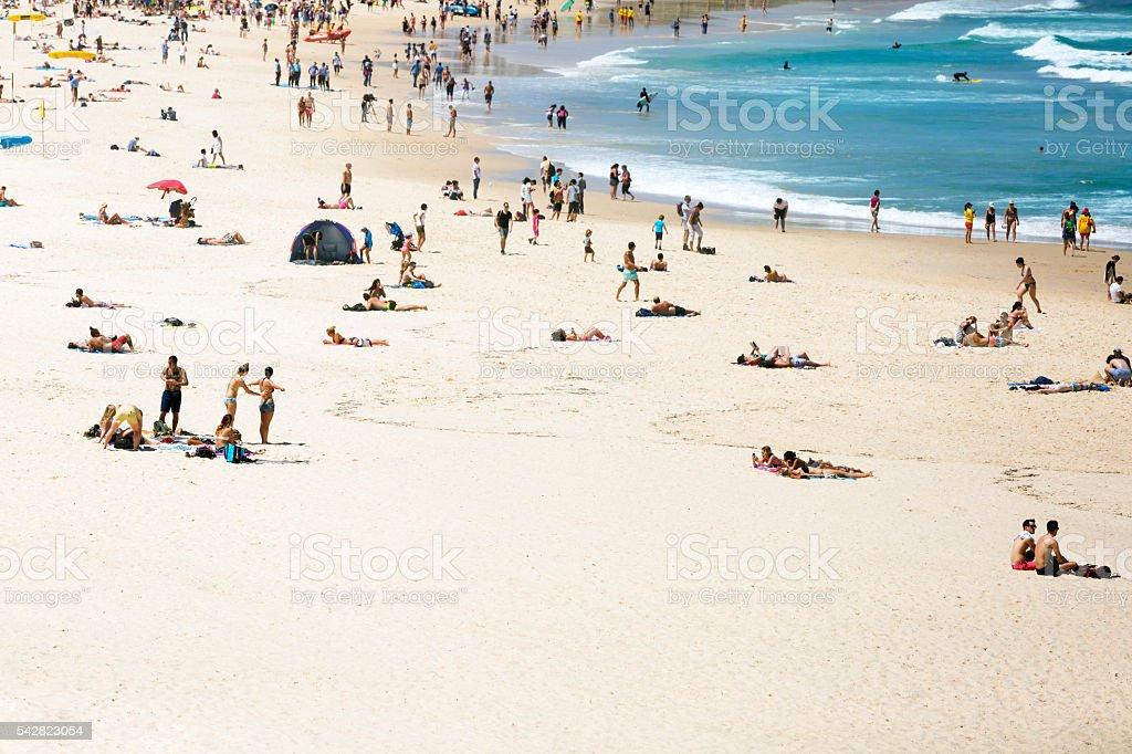 Summer at the beach with crowd of beachgoers, Sydney Australia stock photo