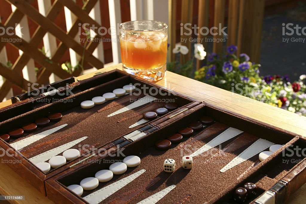 Summer Backgammon and a Pimms Cup stock photo