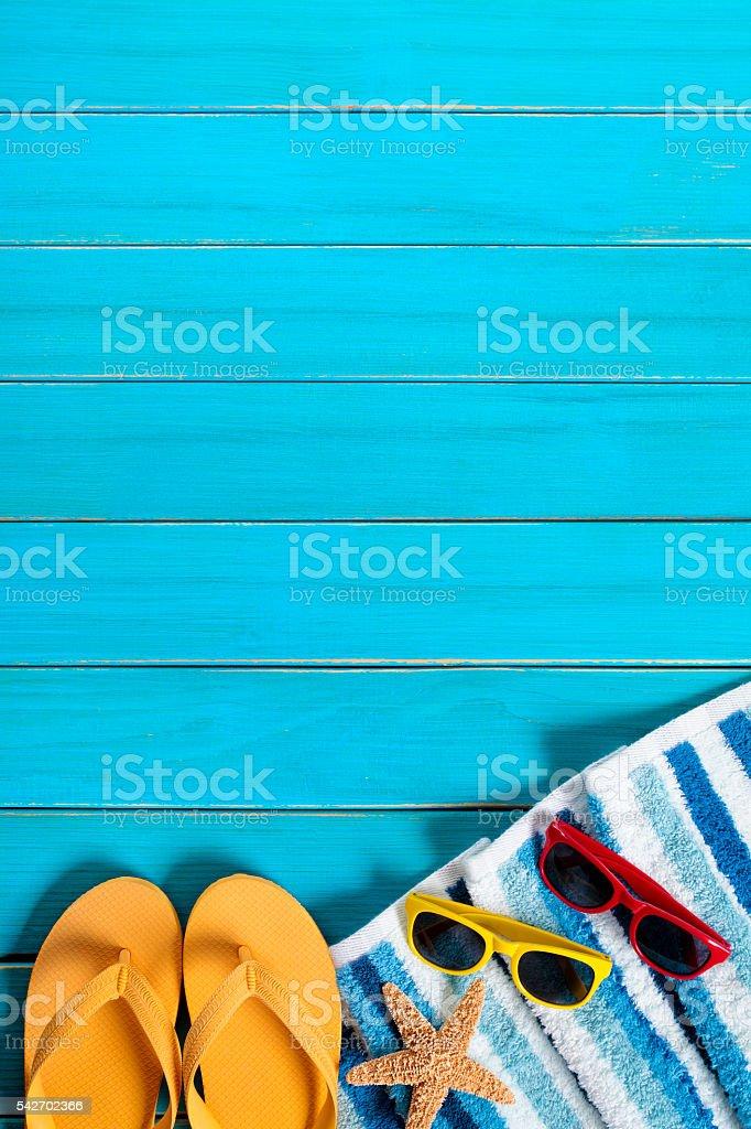 Summer beach background border, sunglasses, flip flops, starfish stock photo