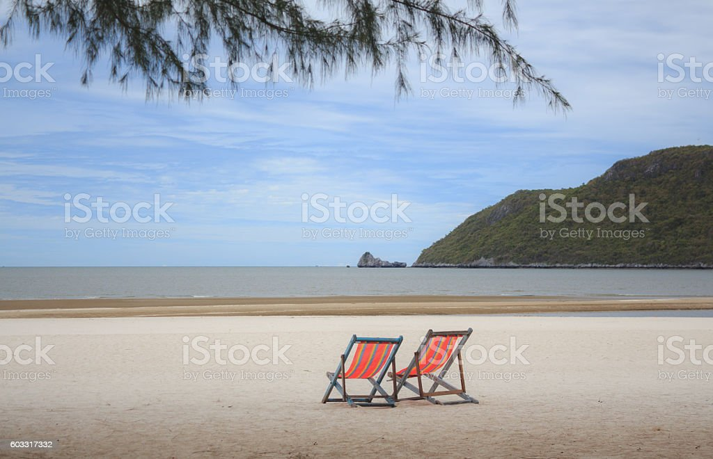 summer beach chairs for relax on beach in vacation time Стоковые фото Стоковая фотография