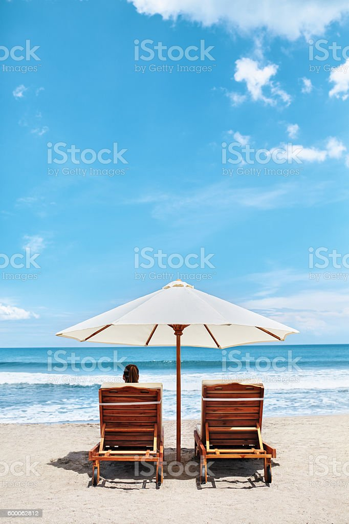 Summer Beach. Holidays Vacations. Woman Relaxing, Deck Chairs stock photo