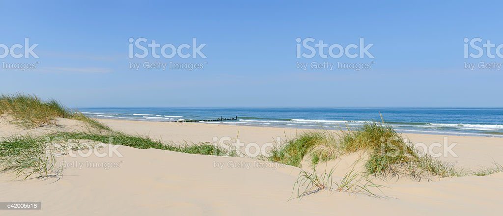 Summer beach panorama with sand dunes and blue sky stock photo