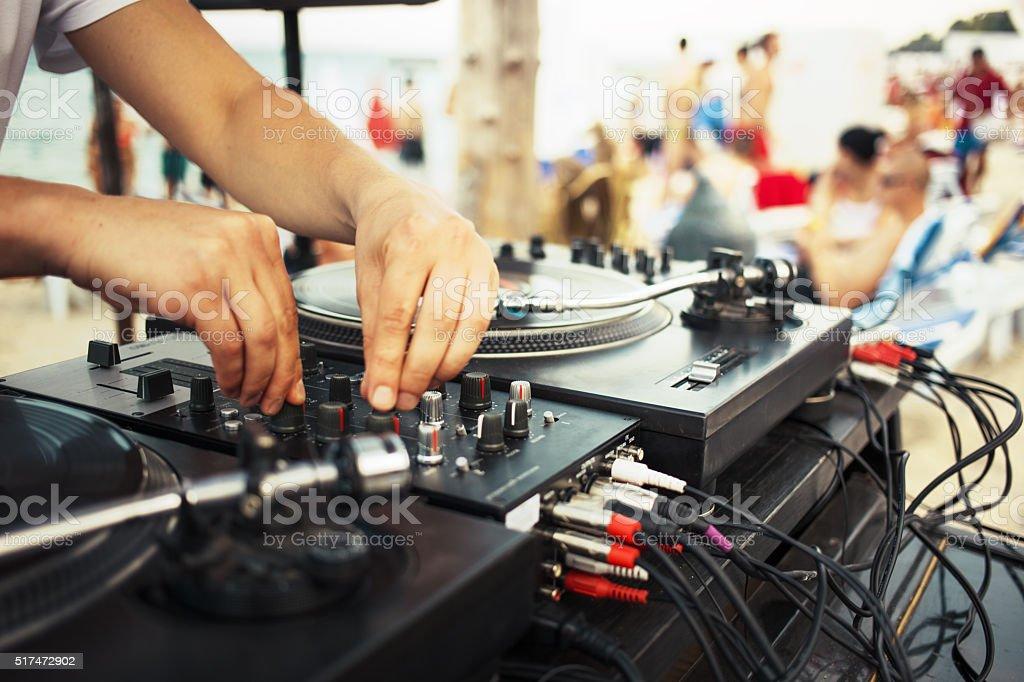 Summer beach party - dj playing vinyl stock photo