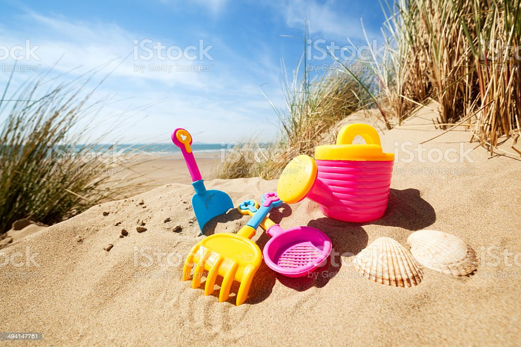 Summer beach toys in the sand stock photo