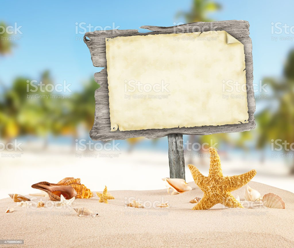 Summer beach with blank wooden poster stock photo