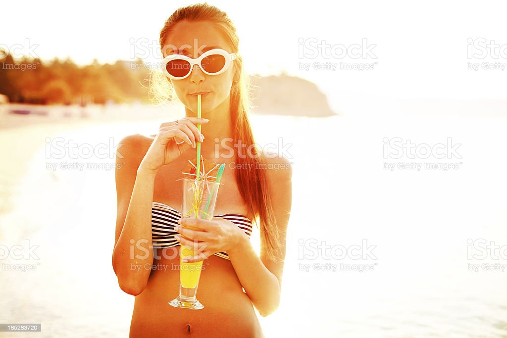 Summer beauty with a cocktail stock photo