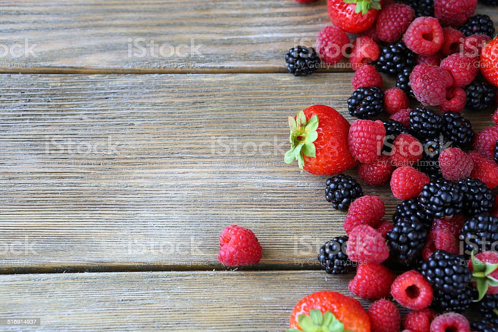 Summer berries on wooden background stock photo