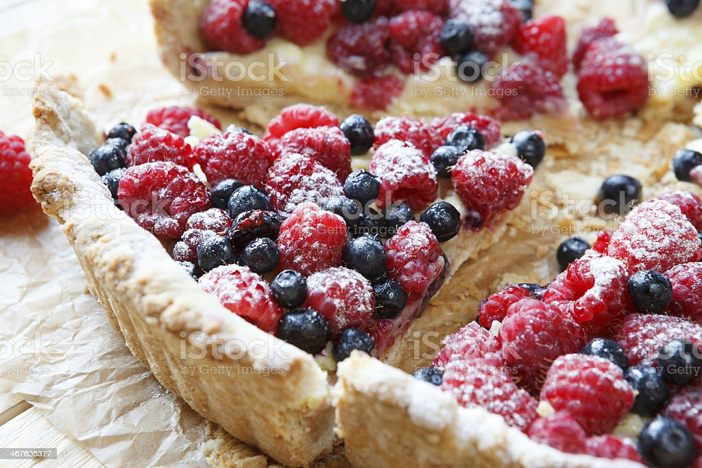 summer berry tart with custard cream stock photo