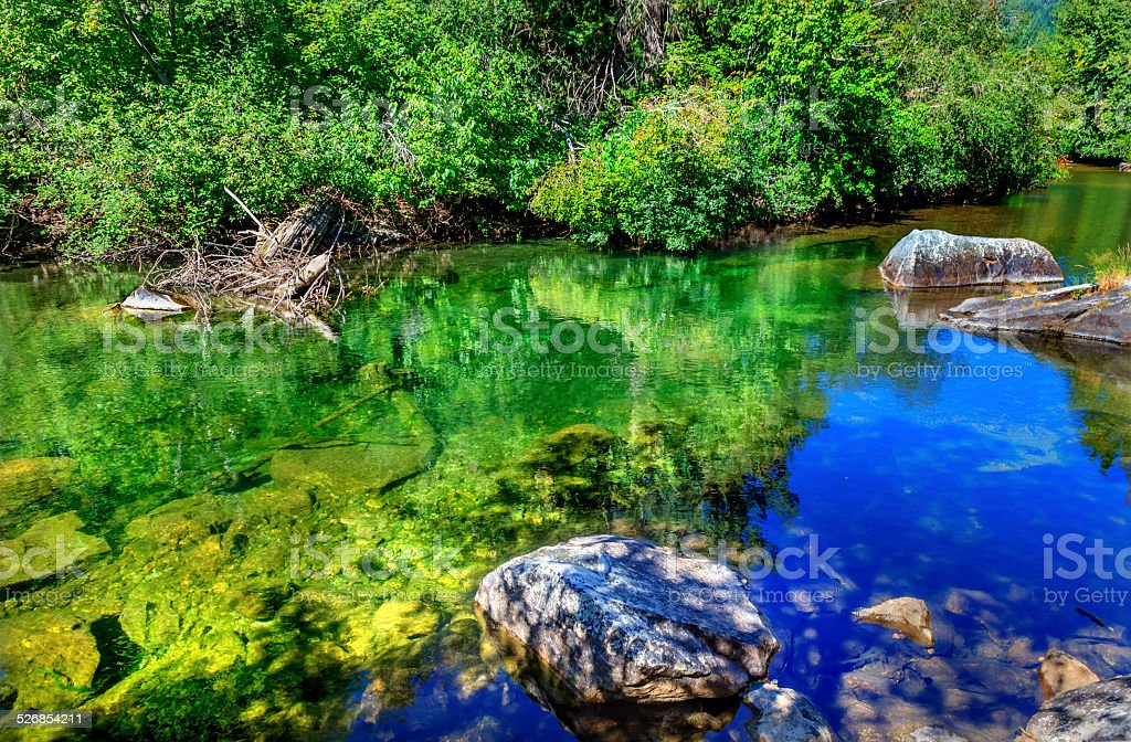 Summer Blue Green Colors Reflection Rocks Wenatchee River Washington stock photo