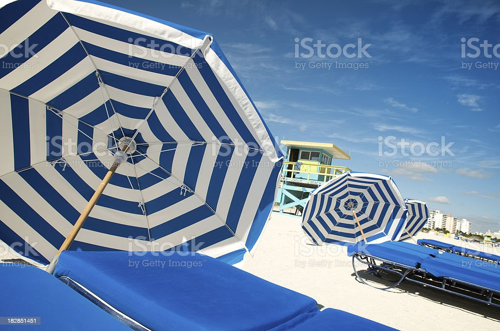 Summer Blue White Stripes Beach Umbrellas and Loungers royalty-free stock photo
